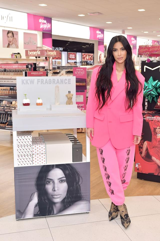 "<p>In a hot pink suit jacket with pink sweatpants featuring pictures of little heads, launching <a rel=""nofollow"" href=""https://www.harpersbazaar.com/celebrity/latest/a25295627/kim-kardashian-north-west-dream-kardashian-instagram-makeup-videos/"">KKW Beauty</a> at ULTA Beauty in Calabasas, California. </p>"