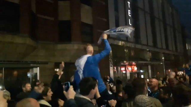 Brighton and Hove Albion players celebrate with fans after historic promotion to Premier League