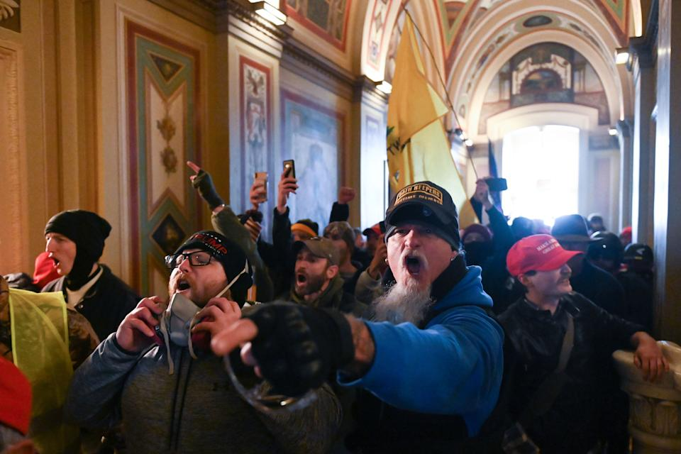 TOPSHOT - Supporters of US President Donald Trump protest inside the US Capitol on January 6, 2021, in Washington, DC. - Demonstrators breeched security and entered the Capitol as Congress debated the a 2020 presidential election Electoral Vote Certification. (Photo by ROBERTO SCHMIDT / AFP) (Photo by ROBERTO SCHMIDT/AFP via Getty Images)