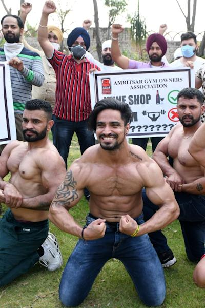Lockdown or not, many of these fitness aficionados managed to stay in good shape to pose for pictures (AFP Photo/NARINDER NANU)