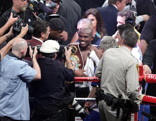 Timothy Bradley (C) of the US celebrates defeating Manny Pacquiao of the Philippines following their WBO welterweight title match  at the MGM Grand Arena on June 9, 2012 in Las Vegas, Nevada.  In what is being viewed as a highly controversial outcome, unbeaten Bradley ended Pacquiao's long unbeaten run with a split decision victory over the Filipino ring icon.     AFP PHOTO /  John GurzinskiJOHN GURZINSKI/AFP/GettyImages