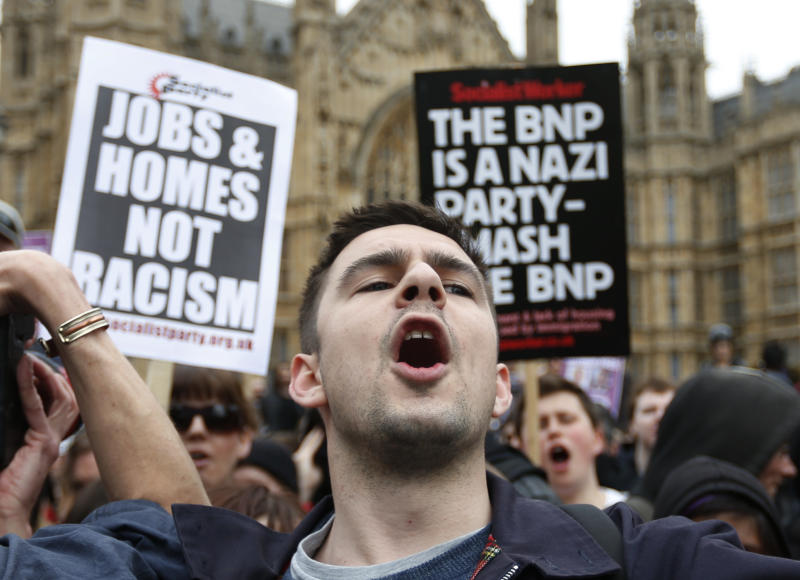 Anti-fascist demonstrators shout slogans against members of the British National Party (BNP), not seen, during a demonstration in central London, Saturday, June 1, 2013. BNP supporters gathered to protest the May 22 killing of British soldier Lee Rigby. (AP Photo/Lefteris Pitarakis)