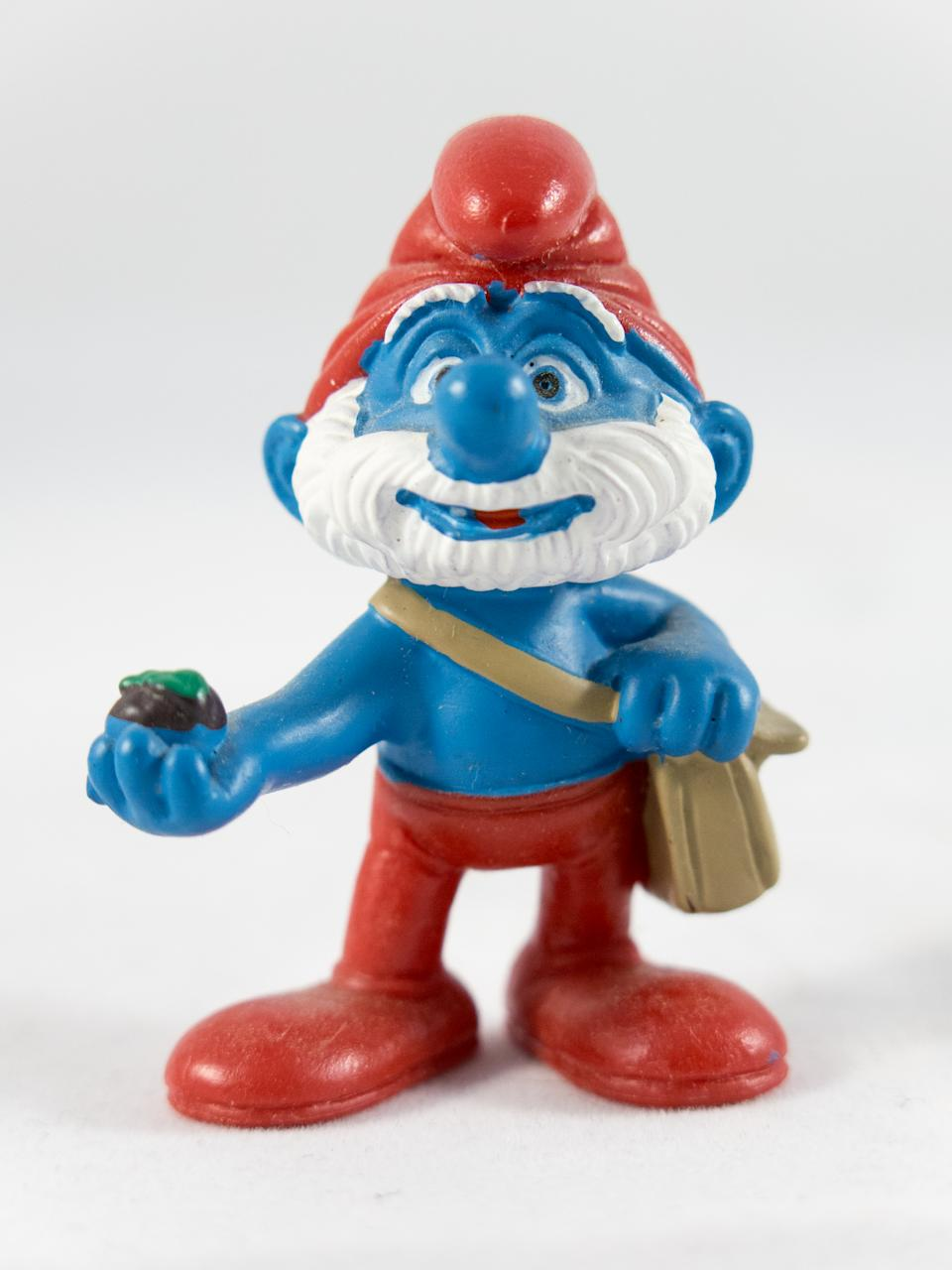 Milan, Italy - May 28th 2016: close up on Papa Smurf plastic toy, resting on a white background. Nothing else is visible in the frame.