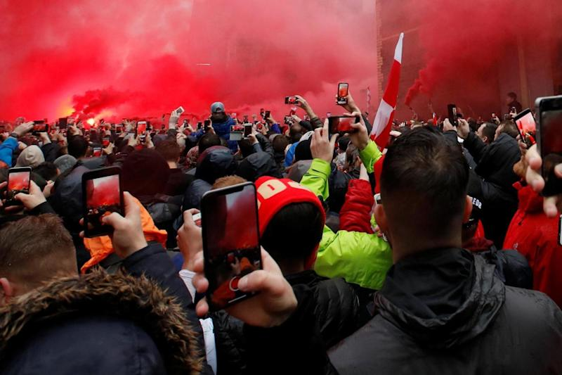 Flares were let off outside the ground ahead of the game (REUTERS)