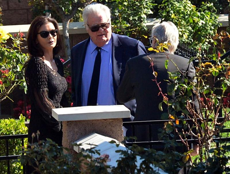Catherine Zeta-Jones, Joel Douglas and Michael Douglas | London Entertainment / Splash