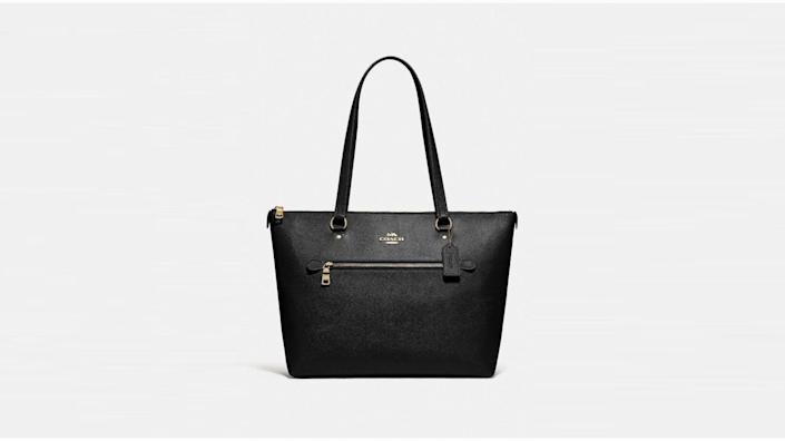 This tote features interior and exterior storage.