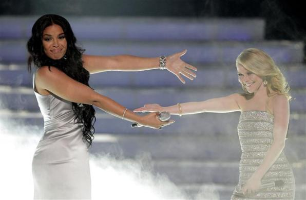 "Jordin Sparks (L) and Hollie Cavanagh after their performance during the 11th season finale of ""American Idol"" in Los Angeles, California, May 23, 2012."