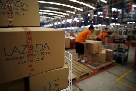 Alibaba to invest additional 1.44 billion pounds in Lazada, replaces CEO