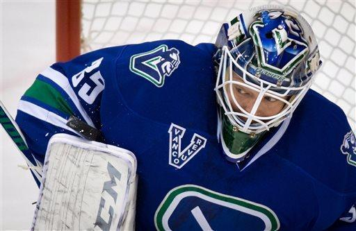 Vancouver Canucks goalie Cory Schneider makes a save against the Detroit Red Wings during the first period of an NHL hockey game in Vancouver, British Columbia, on Saturday April 20, 2013. (AP Photo/The Canadian Press, Darryl Dyck)