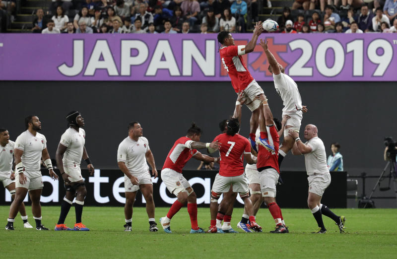 Tonga's Sam Lousi is held aloft as he wins a lineout during the Rugby World Cup Pool C game at Sapporo Dome between England and Tonga in Sapporo, Japan, Sunday, Sept. 22, 2019. (AP Photo/Aaron Favila)