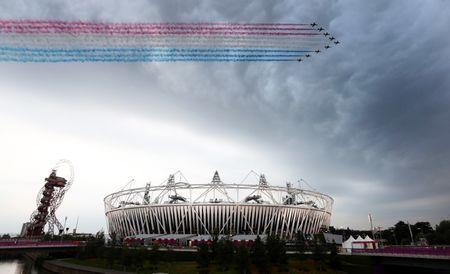 Olympics - London 2012 Olympic Games - Opening Ceremony - Olympic Park, Stratford, London - 27/7/12 General view of the Red Arrows flying over the Olympic Stadium during the Opening Ceremony Mandatory Credit: Action Images / Steven Paston Livepic