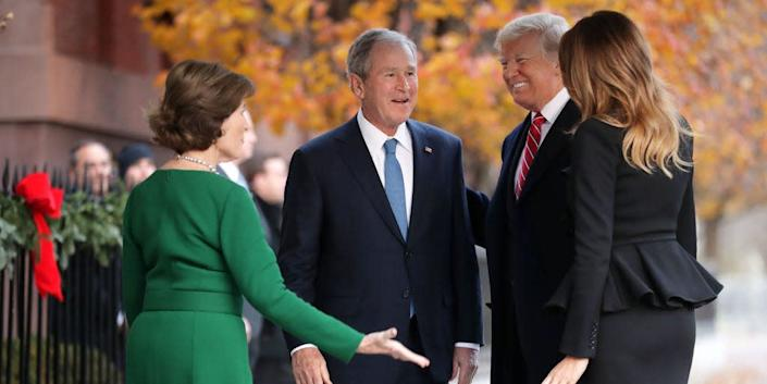 Former first lady Laura Bush and former President George W. Bush greet President Donald Trump and first lady Melania Trump outside of Blair House December 04, 2018 in Washington, DC.