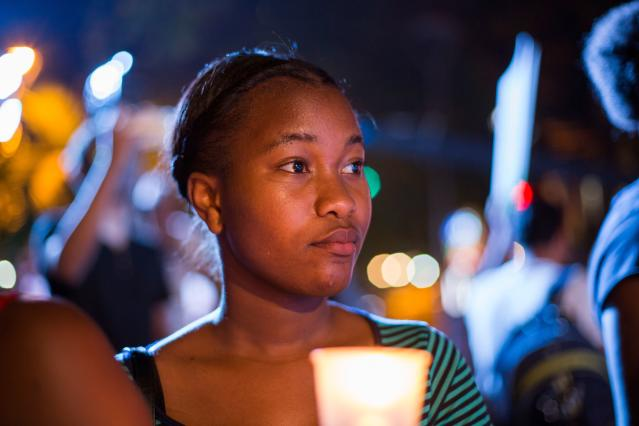 <p>A woman holds a candle during a demonstration on the eve of the commemoration of the International Day for the Elimination of Violence Against Women, in Santo Domingo on Nov. 24, 2017. (Photo: Erika Santelices/AFP/Getty Images) </p>
