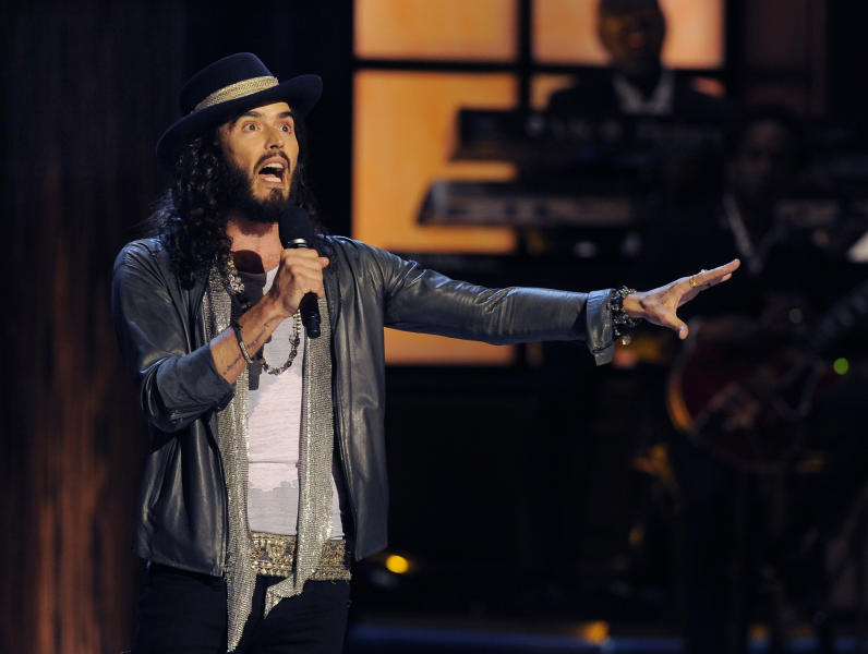 """Comedian Russell Brand performs at """"Eddie Murphy: One Night Only,"""" a celebration of Murphy's career at the Saban Theater on Saturday, Nov. 3, 2012, in Beverly Hills, Calif. (Photo by Chris Pizzello/Invision)"""