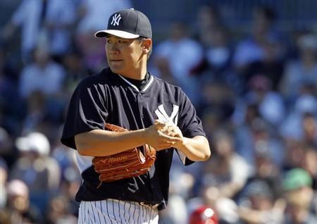 Mar 1, 2014; Tampa, FL, USA; New York Yankees pitcher Masahiro Tanaka (19) looks on during the sixth inning against the Philadelphia Phillies at George M. Steinbrenner Field. Kim Klement-USA TODAY Sports