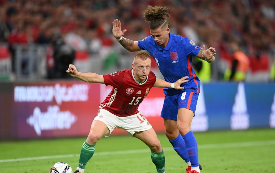 Kalvin Phillips of England and Laszlo Kleinheisler of Hungary battle for the ball during the 2022 FIFA World Cup Qualifier match between Hungary and England at Stadium Puskas Ferenc on September 02, 2021 in Budapest, Hungary. - GETTY IMAGES