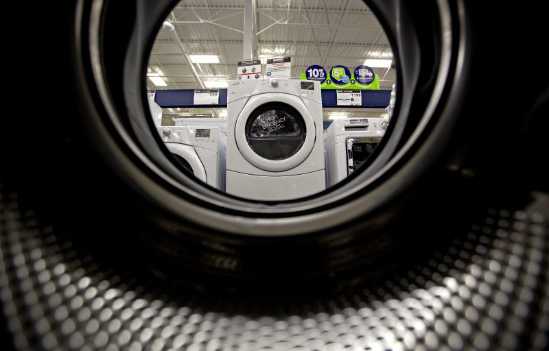 In this Tuesday, June 19, 2012 photo, washing machines sit on display on a showroom floor at a Lowe's store in Atlanta. Companies cut back on orders for long-lasting U.S. factory goods last month, outside volatile aircraft and other transportation equipment. The decline suggests businesses are losing confidence in the economy. Orders for durable goods rose a seasonally adjusted 1.6 percent in June from May, the Commerce Department said Thursday, July 26, 2012. (AP Photo/David Goldman)