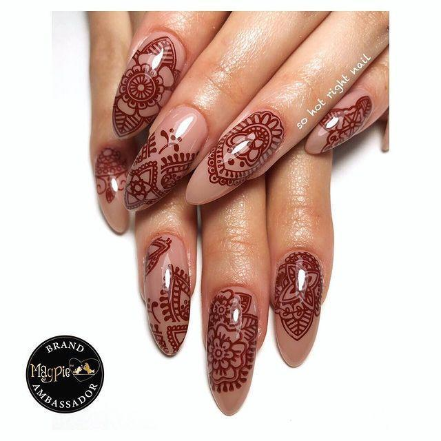"""<p>Why should your henna stop on your hands? This intricate nail design extends it to your nails.</p><p><a href=""""https://www.instagram.com/p/BwXuvOQgnoM/"""" rel=""""nofollow noopener"""" target=""""_blank"""" data-ylk=""""slk:See the original post on Instagram"""" class=""""link rapid-noclick-resp"""">See the original post on Instagram</a></p>"""