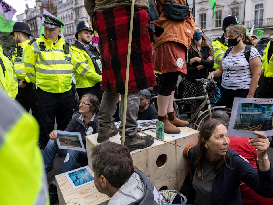 XR protesters lock themselves into position outside HMRC earlier (Getty)