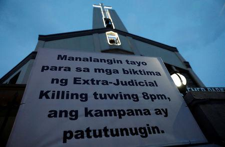 "A sign is posted outside a Catholic church which translates to ""Let us pray for the victims of extrajudicial killings, bells will toll at 8:00pm"" in Quezon City, metro Manila, Philippines September 22, 2017. REUTERS/Dondi Tawatao"