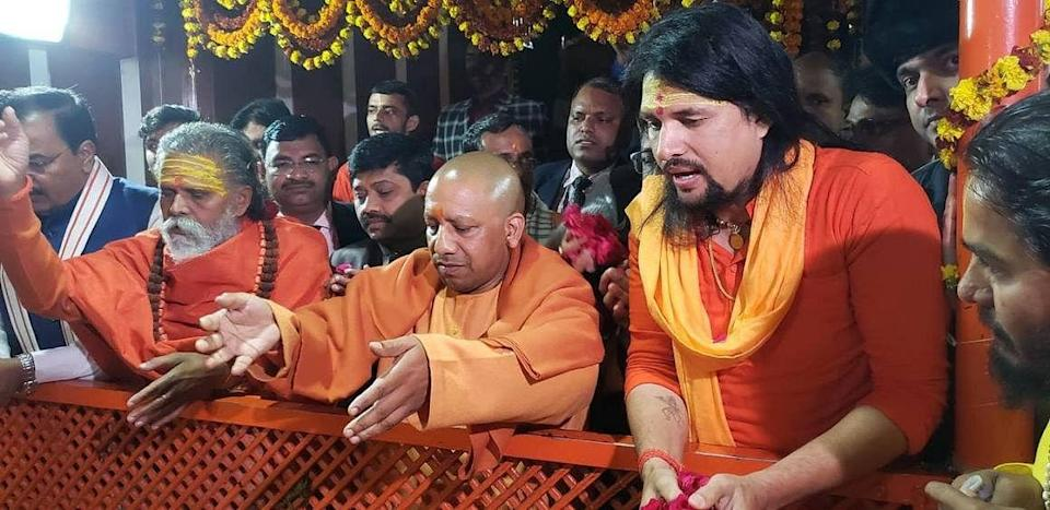 """<div class=""""paragraphs""""><p>Narendra Giri (left) with chief minister Yogi Adityanath and Anand Giri (extreme right)</p></div>"""