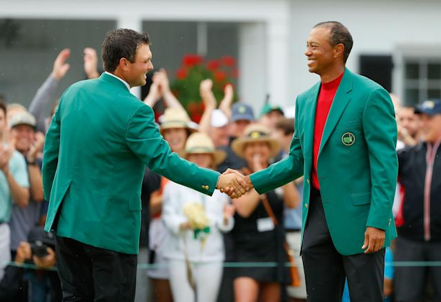 "<div class=""caption""> Tiger shakes hands with <a class=""link rapid-noclick-resp"" href=""/pga/players/11250/"" data-ylk=""slk:Patrick Reed"">Patrick Reed</a> during the Green Jacket Ceremony after winning the 2019 Masters. </div> <cite class=""credit"">Kevin C. Cox/Getty Images</cite>"