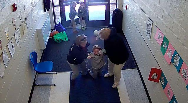 After dragging him along the floor, the teachers eventually lifted the boy up. Photo: Facebook