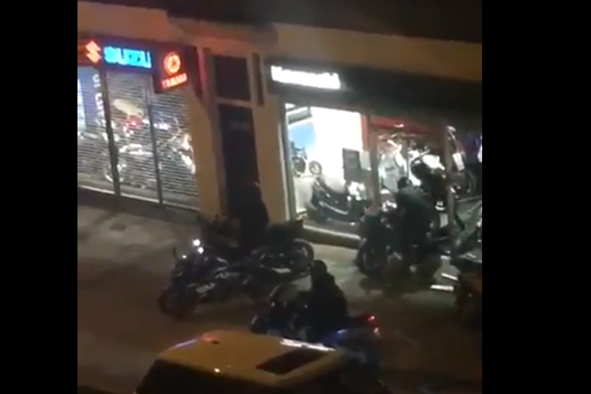 Moped gang caught smashing into luxury bike dealership and stealing one of world's rarest superbikes