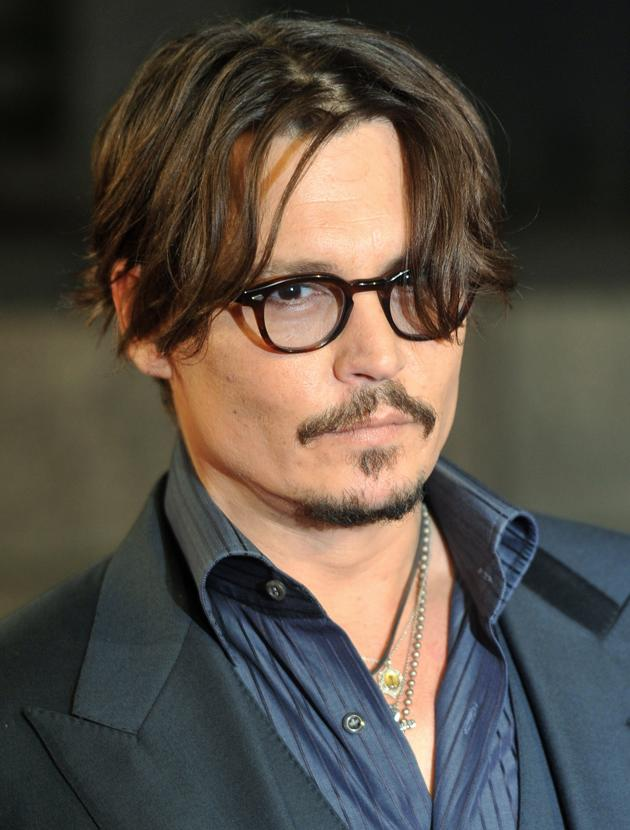 Johnny Depp photos: Is it the floppy mane? Perfect facial hair? Geeky glasses? Who knows the secret to Johnny's sexiness but it's unreal!