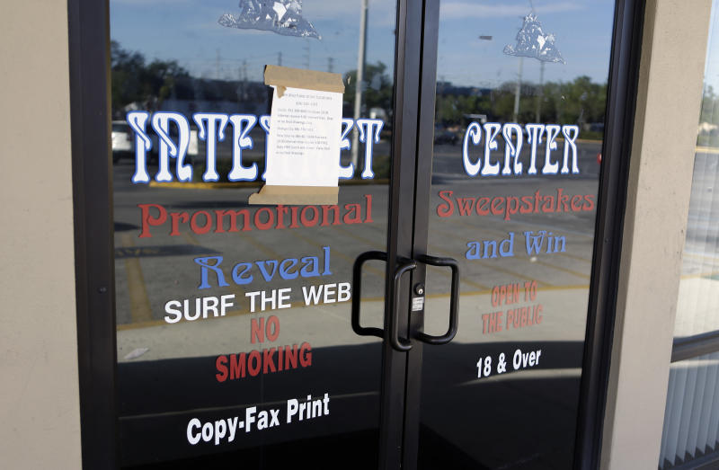 FILE - The entrance to a closed down and vacant Internet Cafe run by Allied Veterans is seen in this March 13, 2013 file photo taken in Casselberry, Fla. Strip-mall parlors with slot-like computer games such as those targeted in the state racketeering and conspiracy investigation have contributed about $100,000 over the past four years to local candidates in Florida, including a sheriff whose agency was a part of the probe, according to a review of records by The Associated Press.  (AP Photo/John Raoux, File)