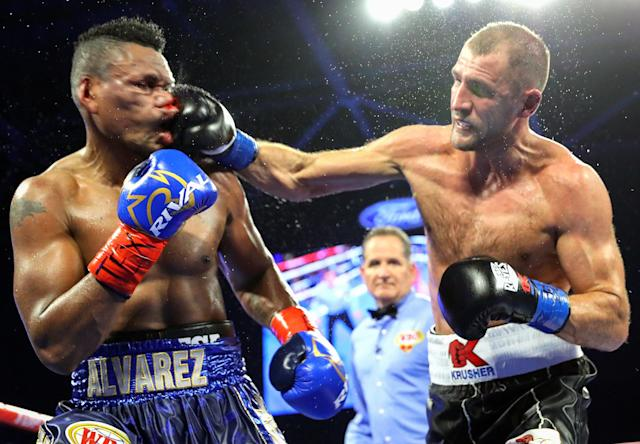 Sergey Kovalev (R) landed 213 punches to Eleider Alvarez's 111 on Saturday in Frisco, Texas. (Mikey Williams/Top Rank)