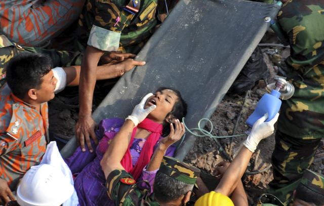 Rescuers carry a survivor pulled out from the rubble of a building that collapsed in Saver, near Dhaka, Bangladesh, Friday, May 10, 2013. Rescue workers in Bangladesh freed the woman buried for 17 days inside the wreckage of a garment factory building that collapsed, killing more than 1,000 people. Soldiers at the site said her name was Reshma and described her as being in remarkably good shape despite her ordeal. (AP Photo)