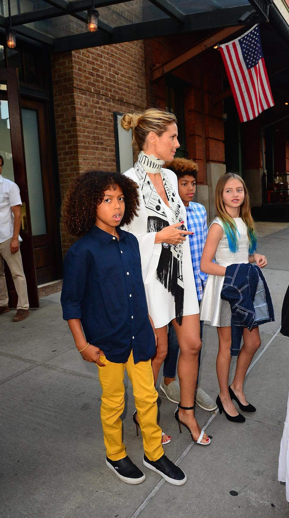 Heidi Klum is defending letting her daughter Leni (pictured in 2016 with brothers Johan and Henry) wear high heels. (Photo: Raymond Hall/GC Images)