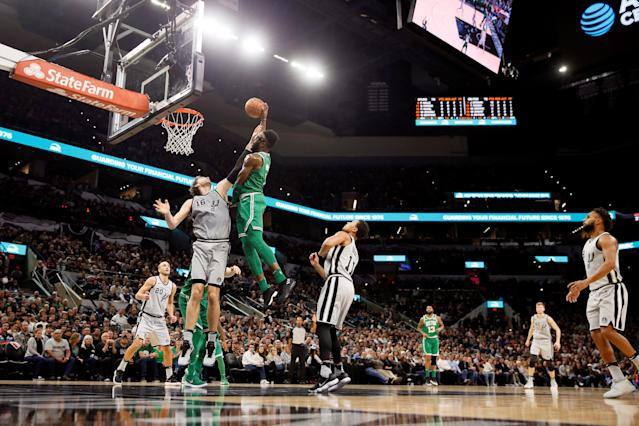 Dec 8, 2017; San Antonio, TX, USA; Boston Celtics shooting guard Jaylen Brown (7) dunks the ball over San Antonio Spurs center Pau Gasol (left) during the second half at AT&T Center. Mandatory Credit: Soobum Im-USA TODAY Sports TPX IMAGES OF THE DAY