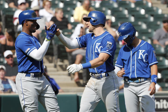 Kansas City Royals' Hunter Dozier, center, celebrates with Jorge Soler, left, and Whit Merrifield, after the trio scored on Dozier's three-run home run off Chicago White Sox starting pitcher Lucas Giolito during the sixth inning of a baseball game Thursday, Sept. 12, 2019, in Chicago. (AP Photo/Charles Rex Arbogast)