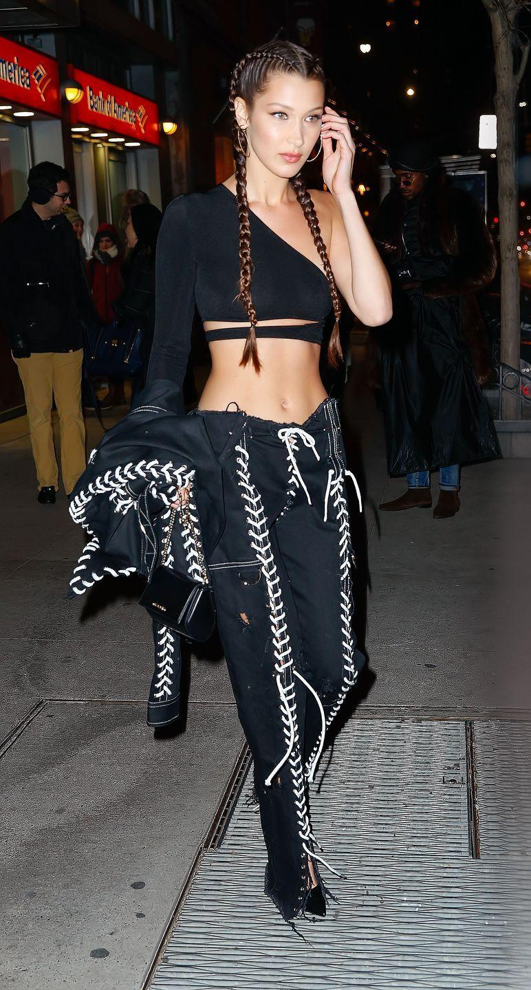 <p>After the release of her <em>Paper</em> magazine cover in New York City wearing a cropped asymmetrical top with Wesley Berryman lace-up jacket and pants and a Givenchy bag. </p>