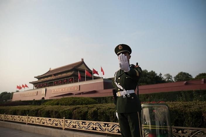 A Chinese paramilitary member stands near Tiananmen square in Beijing, China, on October 22, 2017. The US government has been increasingly worried about Beijing's spying (AFP Photo/Nicolas ASFOURI)