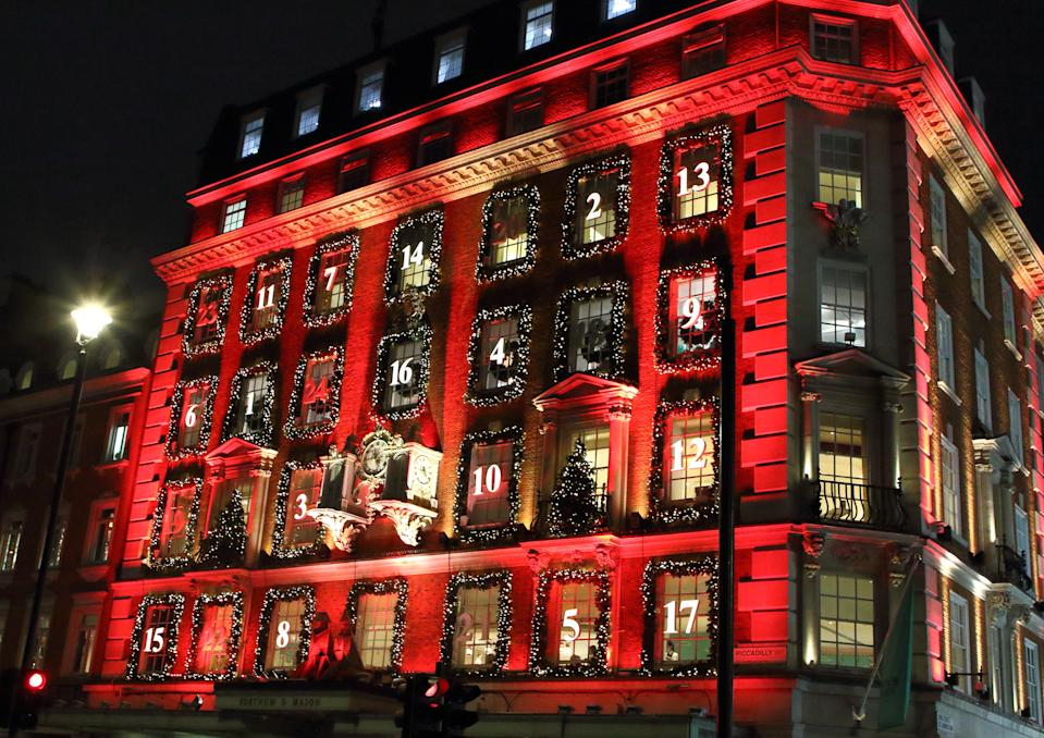 LONDON, UNITED KINGDOM - 2019/12/17: London's upmarket department store Fortnum & Mason in Piccadilly has been transformed into a giant advent calendar this Christmas.  Its iconic facade is bathed in red with its windows decorated and numbered like a traditional advent calendar. Its window displays are also some of the best in the capital for the festive season. (Photo by Keith Mayhew/SOPA Images/LightRocket via Getty Images)