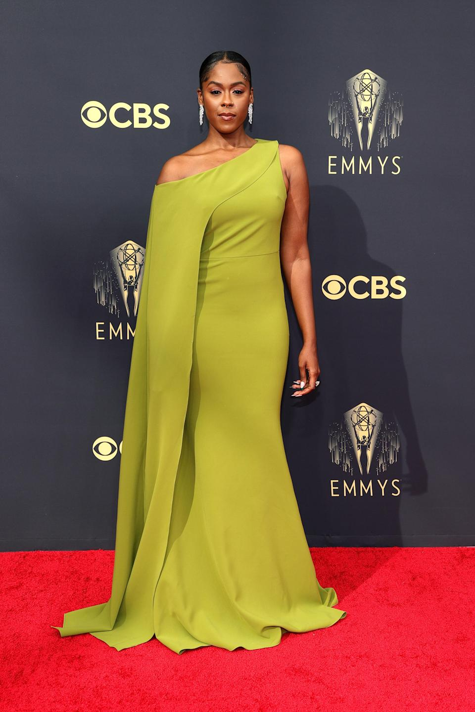 Moses Ingram's avocado-hued off-the-shoulder gown is gorgeous, as are the statement earrings she paired it with. We also loved the chain detail she added to her ponytail.
