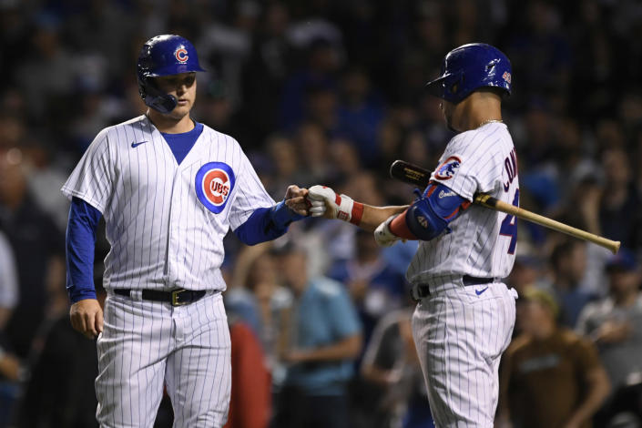 Chicago Cubs' Joc Pederson left, celebrates with teammate Willson Contreras right, at home plate after scoring on a Javier Baez RBI ground rule double during the sixth inning of a baseball game against the Cleveland Indians Tuesday, June 22, 2021, in Chicago. Chicago won 7-1. (AP Photo/Paul Beaty)