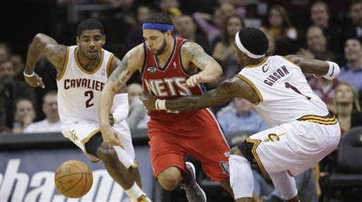 Cleveland Cavaliers' Daniel Gibson (1) fouls New Jersey Nets point guard Deron Williams (8) in the fourth quarter in an NBA basketball game on Friday, Jan. 27, 2012, in Cleveland. Cavaliers' Kyrie Irving (2) pursues. The Nets won 99-96. (AP Photo/Tony Dejak)