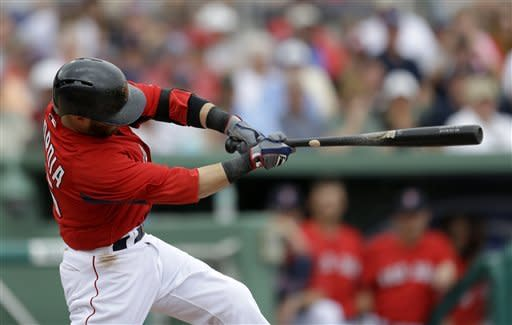 Boston Red Sox's Dustin Pedroia hits a single to score teammate Jacoby Ellsbury in the third inning of a spring training baseball game against the Toronto Blue Jays, Tuesday, March 12, 2013, in Fort Myers, Fla. (AP Photo/David Goldman)