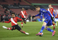 Southampton's Kyle Walker-Peters, left, and Leicester's Jamie Vardy challenge for the ball during the English Premier League soccer match between Southampton and Leicester City at St. Mary's Stadium in Southampton, England, Friday, April 30, 2021. (Michael Steele/Pool via AP)