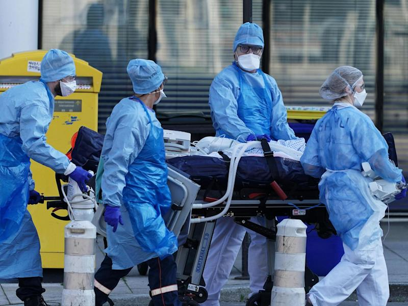 Medical staff move a patient from a train from Strasbourg to an ambulance: EPA