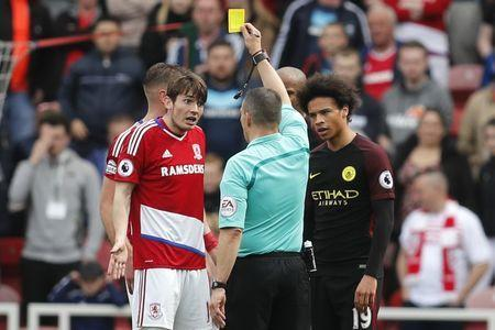 Britain Football Soccer - Middlesbrough v Manchester City - Premier League - The Riverside Stadium - 30/4/17 Middlesbrough's Marten de Roon is shown a yellow card by referee Kevin Friend after conceding a penalty while Manchester City's Leroy Sane looks on Reuters / Russell Cheyne Livepic