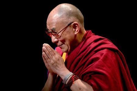 """The Dalai Lama greets the audience after speaking on """"The Virtue of Non-Violence"""" in New York"""