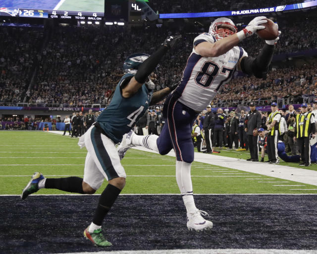"""FILE - In this Feb. 4, 2018, file photo, New England Patriots' Rob Gronkowski (87) makes a touchdown reception against Philadelphia Eagles cornerback Ronald Darby during the second half of the NFL Super Bowl 52 football game in Minneapolis. Gronkowski says he is retiring from the NFL after nine seasons. Gronkowski announced his decision via a post on Instagram Sunday, March 24, 2019, saying that a few months shy of this 30th birthday """"its time to move forward and move forward with a big smile."""" (AP Photo/Chris O'Meara. File)"""