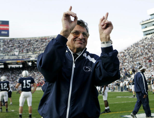 FILE - In this Nov. 5, 2005, file photo, Penn State football coach Joe Paterno acknowledges the crowd during warm-ups before an NCAA college football game against Wisconsin in State College, Pa. Paterno aims to tell the polarizing story of a legends fall, when the most essential question can never be answered. The HBO movie directed by Barry Levinson debuts April 7 and stars Oscar winner Al Pacino as Joe Paterno, the Penn State coach whose career ended in scandal. (AP Photo/Carolyn Kaster, File)