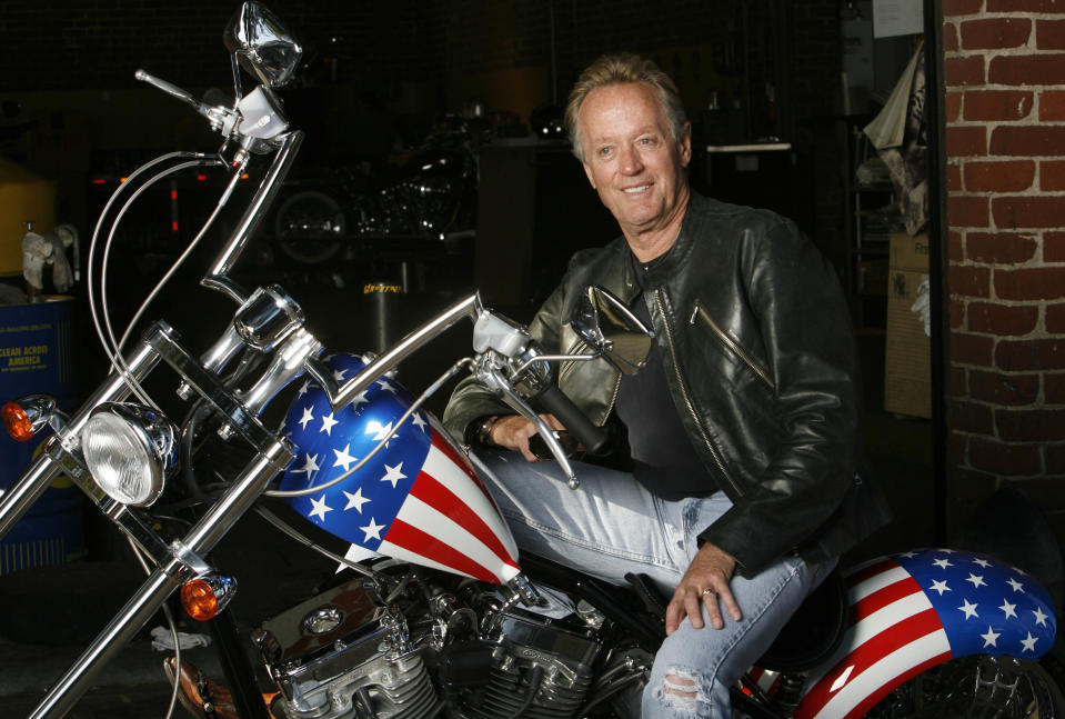 """Actor Peter Fonda poses for a portrait on a replica of the """"Captain America"""" bike in Glendale, California October 23, 2009. Fonda was promoting the recent release on blu-ray disk of the 1969 movie """"Easy Rider"""" on its 40th anniversary.   REUTERS/Mario Anzuoni   (UNITED STATES ENTERTAINMENT)"""