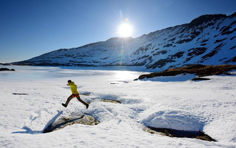 Northern exposure: Sunday walking at the frozen edges of Red Tarn on Helvellyn in the Lake District, already covered in deep snow and ice - © North News & Pictures - northnews.co.uk